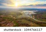 aerial photovoltaic solar... | Shutterstock . vector #1044766117
