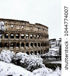 colosseum in the snow. | Shutterstock . vector #1044774007
