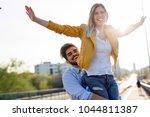 couple in love having fun... | Shutterstock . vector #1044811387