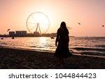 girl on the jbr beach with ain...   Shutterstock . vector #1044844423