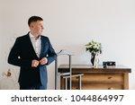 buttoning a jacket hands close...   Shutterstock . vector #1044864997