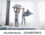 happy kids playing in white...   Shutterstock . vector #1044895843