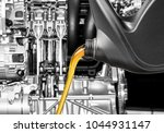 pouring oil lubricant motor car ... | Shutterstock . vector #1044931147