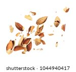 almonds is torn to pieces on... | Shutterstock . vector #1044940417