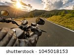 pov of motorbiker holding... | Shutterstock . vector #1045018153