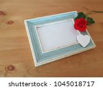 single rose laying on a vintage ... | Shutterstock . vector #1045018717