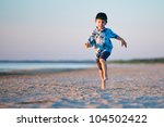 Kid Runs On The Beach at sunset - stock photo