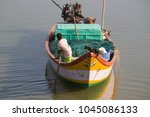 one young fisherman boy riding... | Shutterstock . vector #1045086133