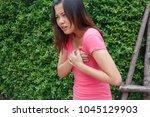 sporty woman having heart... | Shutterstock . vector #1045129903