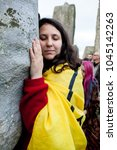 Small photo of Stonehenge, Wiltshire / United Kingdom - 06/22/2017: A reveller hugs the stones at Stonehenge, during the Summer Solstice celebrations