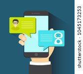 chatbot concept. man chatting... | Shutterstock .eps vector #1045173253