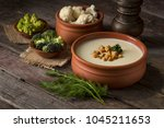 cauliflower cream soup... | Shutterstock . vector #1045211653