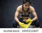 asian female boxer wearing... | Shutterstock . vector #1045212607