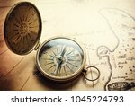 old vintage retro compass on... | Shutterstock . vector #1045224793