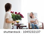 mother  playing with her... | Shutterstock . vector #1045232137