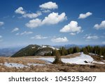 spring landscape in mountains.... | Shutterstock . vector #1045253407