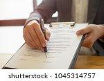 close up business man reaching... | Shutterstock . vector #1045314757