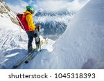 a skier wearing bright jacket... | Shutterstock . vector #1045318393