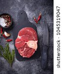 raw meat osso buco on slate... | Shutterstock . vector #1045319047