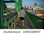 handsome male runner jogging on ... | Shutterstock . vector #1045328407