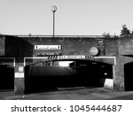 Small photo of Salisbury, Wiltshire, England - July 25, 2017: Monochrome Central car park ramp leading up to addition parking spaces for Sainsburys store