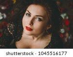 beautiful girl. rose petals.... | Shutterstock . vector #1045516177