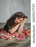 beautiful girl. rose petals.... | Shutterstock . vector #1045517737
