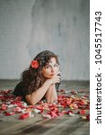 beautiful girl. rose petals.... | Shutterstock . vector #1045517743