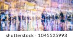 people walking on rainy city... | Shutterstock . vector #1045525993