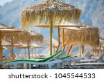 beach sunshades on the southern ... | Shutterstock . vector #1045544533