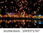people release sky lanterns to... | Shutterstock . vector #1045571767