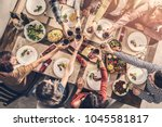 group of people having meal... | Shutterstock . vector #1045581817