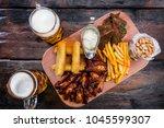 assorted beer snacks with... | Shutterstock . vector #1045599307