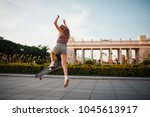 young sporty woman riding on... | Shutterstock . vector #1045613917