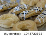 many sweet cakes on a pallet... | Shutterstock . vector #1045723933