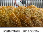 bread with grains lies on the... | Shutterstock . vector #1045723957