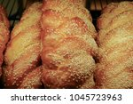 freshly baked bread in a shop... | Shutterstock . vector #1045723963