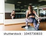 young fitness woman performing... | Shutterstock . vector #1045730833