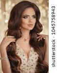 sexy brunette in gold. fashion... | Shutterstock . vector #1045758943