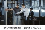 security agent at an airport... | Shutterstock . vector #1045776733
