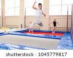 family in trampoline center | Shutterstock . vector #1045779817