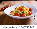 fresh pasta with garlic cherry... | Shutterstock . vector #1045795147