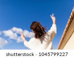 beautiful young woman making... | Shutterstock . vector #1045799227