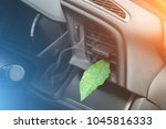 green leaf in the car air.... | Shutterstock . vector #1045816333