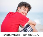 teen boy on sand on beach  ... | Shutterstock . vector #1045820677