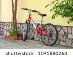 a bicycle stands against the... | Shutterstock . vector #1045880263