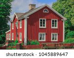old  historic single townhouse | Shutterstock . vector #1045889647
