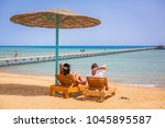 couple on romantic holidays at... | Shutterstock . vector #1045895587