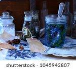 herbal tea in a jar with old... | Shutterstock . vector #1045942807