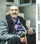 old poor and homeless gypsy man ... | Shutterstock . vector #1045994977